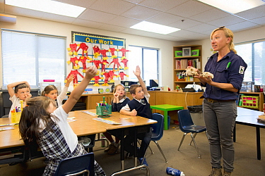 Conservation Canines field technician, Julianne Ubigau, teaching second grade students about their work, Washington