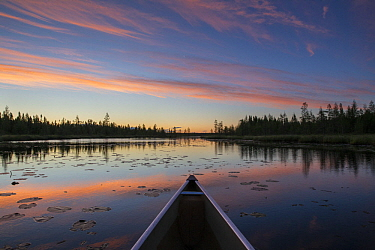 Kayak in lake at sunrise near Grand Marais, Minnesota