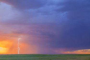 Lightning strike over prairie, Badlands National Park, South Dakota