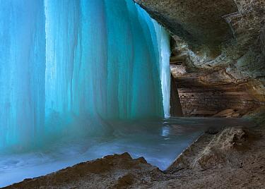 Light shining through frozen Minnehaha Falls, Minneapolis, Minnesota