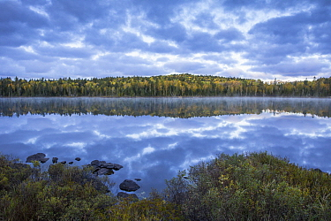 Clouds reflect on calm surface of Swamper Lake in autumn, Superior National Forest, Minnesota