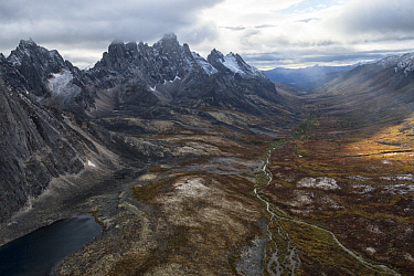 River flowing through valley in autumn, Tombstone Mountains, Tombstone Territorial Park, Yukon, Canada