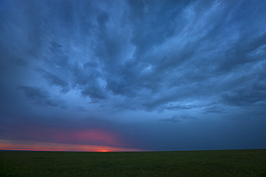 Steppe with storm clouds after sunset, eastern Mongolia
