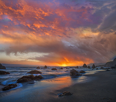 Sunset along coast near Arch Rock, California