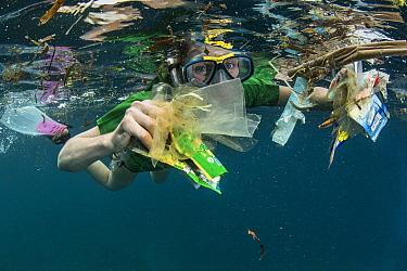 Plastic trash collected by snorkeler, Lesser Sunda Islands, Indonesia