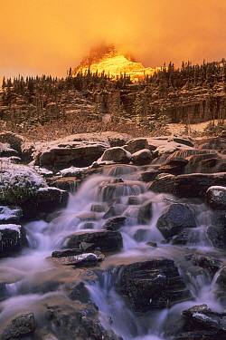 River in winter below mountain, Clements Mountain, Glacier National Park, Montana