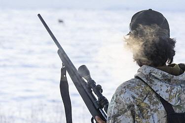 Caribou (Rangifer tarandus) Gwichin hunter, Clifton Salu, looking for caribou in winter, Yukon, Canada