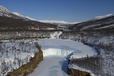 Frozen river in valley in winter, Putoransky State Nature Reserve, Putorana Plateau, Siberia, Russia