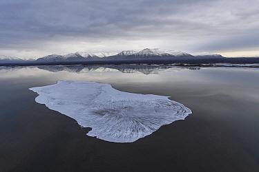 Ice near coast with mountains, Putoransky State Nature Reserve, Putorana Plateau, Siberia, Russia