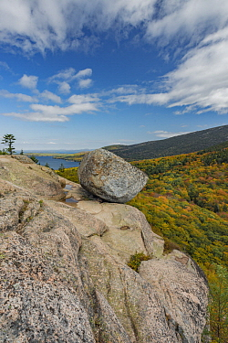 Glacial granite rock and deciduous forest in autumn, Bubble Rock, Jordon Pond, Mount Desert Island, Acadia National Park, Maine
