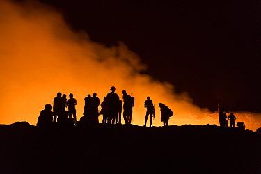 Tourists on crater rim of active volcanic crater, Danakil Depression, Ethiopia