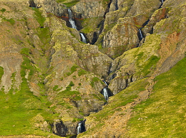 Waterfalls falling down steep rock cliff, Westfjords, Iceland