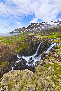 River with waterfalls in tundra, Klifbrekkufossar Waterfall, Mjoifjordur, Iceland