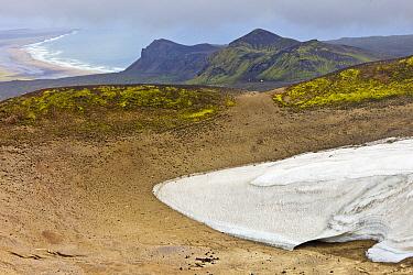 Remnants of snow among lava field, Snaefellsjoekull National Park, Snaefellsnes Peninsula, Iceland