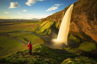 Hiker at Seljalandsfoss Waterfall, Iceland