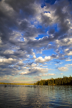 Lake in autumn with cumulus clouds, Dryden Lake, Ontario, Canada