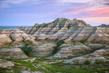 Sandstone rock formations at sunset over Badlands National Park, South Dakota