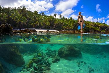 Snorkeler at tidal rock pool, Christmas Island, Australia