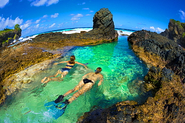 Snorkelers in tidal rock pool, Christmas Island, Australia
