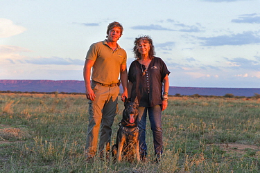 Domestic Dog (Canis familiaris), scent detection dog, with Cheetah (Acinonyx jubatus) conservationist, Laurie Marker, and staff member, Cheetah Conservation Fund, Namibia
