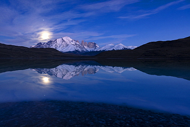 Mountains and moon reflected in lake, Paine Massif, Torres del Paine, Torres del Paine National Park, Patagonia, Chile