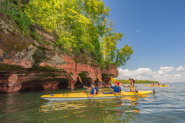 Kayakers and eroded lakeshore, Apostle Islands National Lakeshore, Lake Superior, Wisconsin