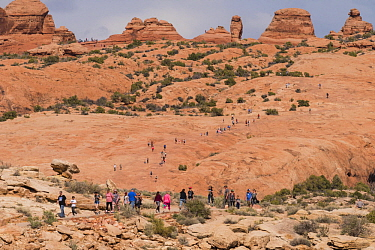 Large number of tourists on overcrowded hiking trail, Delicate Arch, Arches National Park, Utah