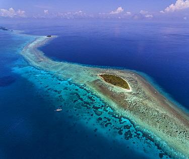 Ship near tropical island, near Yanaba Island, Papua New Guinea