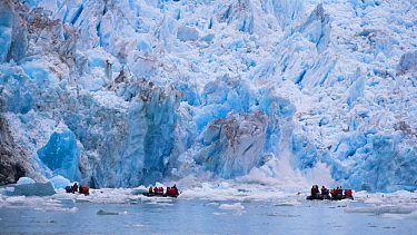 Tourists and calving glacier, South Sawyer Glacier, Alaska