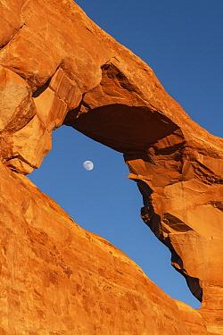 Full moon through Skyline Arch, Arches National Park, Utah