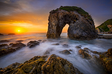 Coastal rock arch at sunset, Bermagui, New South Wales, Australia