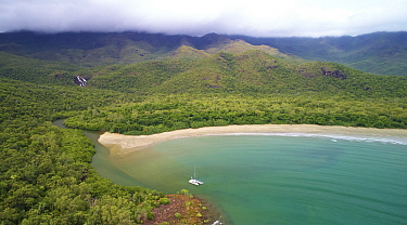 Boat in Zoe Bay surrounded by rainforest, Hinchinbrook Island National Park, Queensland, Australia