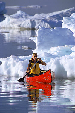 Canoeist on Hudson Bay among pack ice, Churchill, Manitoba, Canada  -  Matthias Breiter