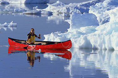 Female canoeist on Hudson Bay among pack ice, Churchill, Manitoba, Canada  -  Matthias Breiter