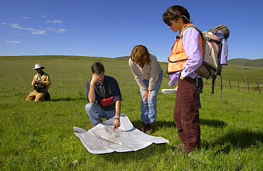 Robert Taylor, Phil Shephard, Catherine Parks, and Susan Geer study a map before surveying The Nature Conservancy's Zumwalt Prairie Preserve for non-native and invasive weeds  -  Michael Durham