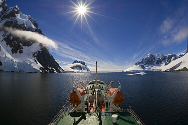 Ship near coast, Lemaire Channel, Antarctic Peninsula, Antarctica