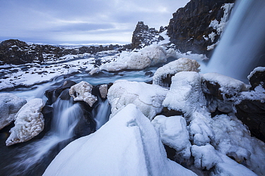 Waterfall and river in winter, Oxararfoss Waterfall, Oxara River, Thingvellir National Park, Iceland