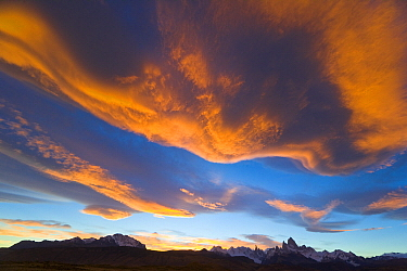 Lenticular and cumulus clouds near granite peaks, Fitzroy Massif, Los Glaciares National Park, Patagonia, Argentina