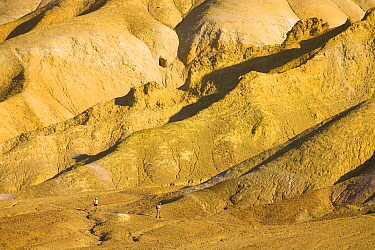 Hikers in desert, Golden Canyon, Death Valley National Park, California