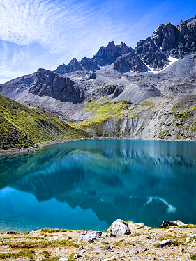 Alpine lake and mountains and the GR5 trail, Sainte Anne Lake, Queyras Regional Nature Park, Ceillac, Alps, France