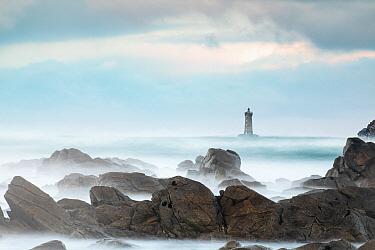 Rocky shore and Porspoder lighthouse, Bretagne, France