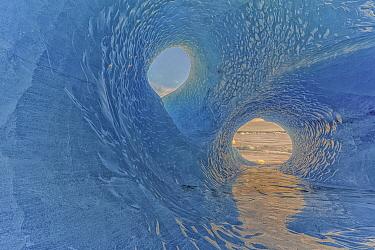 Rare moulin hole in iceberg a mile off shore, Fjallsarlon, Iceland