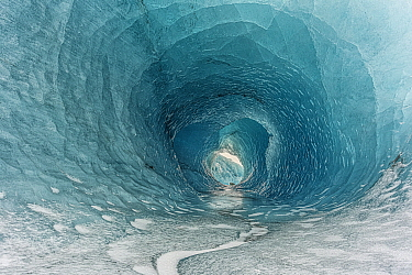Rare moulin ice hole in iceberg a mile off shore, Fjallsarlon, Iceland
