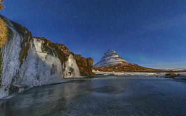 Frozen waterfall and mountain at night, Grundarfjordur, Iceland