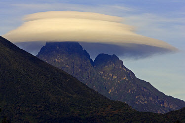 Mikeno Volcano (3634 meters) with lenticular cloud, Republic of the Congo in the Virunga heartland, view from Rwanda  -  Ingo Arndt