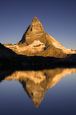 Matterhorn with reflection in Riffelsee Lake, Alps, Switzerland  -  Ingo Arndt