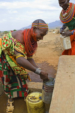 Samburu collecting fresh drinking water at Namunyak Wildlife Conservancy well built by Lewa Wildlife Conservancy, Kenya  -  Suzi Eszterhas