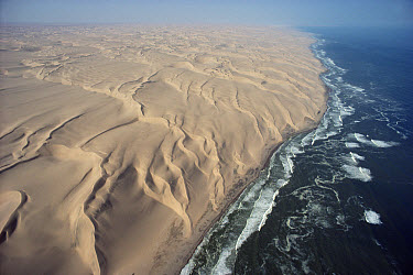 Aerial view of Namib Desert meeting Atlantic Ocean at the Skeleton Coast, Namibia  -  Jim Brandenburg