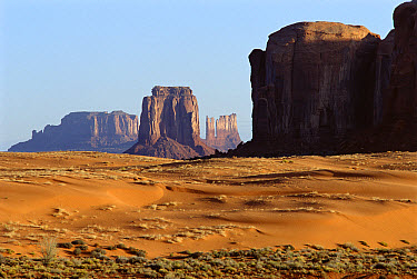 Eroded buttes and sand dunes in Monument Valley Navajo Tribal Park, Arizona  -  Jim Brandenburg