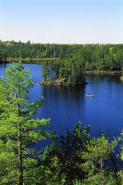 Tourist canoeing in Discovery Lake, Boundary Waters Canoe Area Wilderness, Minnesota  -  Jim Brandenburg